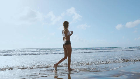 Woman bare foot walking on the summer beach. close up leg... Stock Video Footage