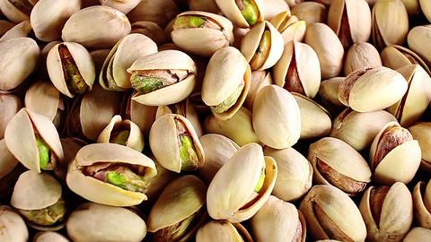 Pistachios. Pistachio texture. Nuts. Green fresh pistachios as texture. Roasted Live Action