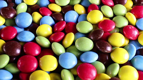 Sugar coated chocolate candy candies colorful background Live Action