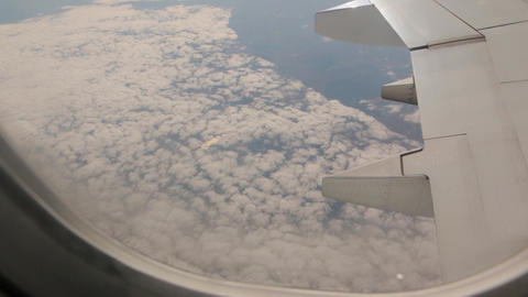 View From Plane Above Clouds GIF