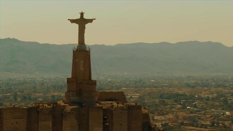 Aerial shot of statue of Chist on ancient Castillo de Monteagudo, Spain Footage