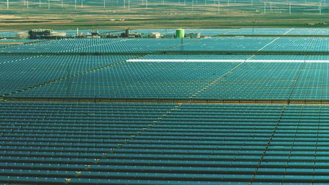 Low altitude flight over solar power plant. Clean energy production Live Action