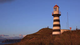 Striped old building of Petropavlovsky Lighthouse on Pacific Coast of Kamchatka Footage