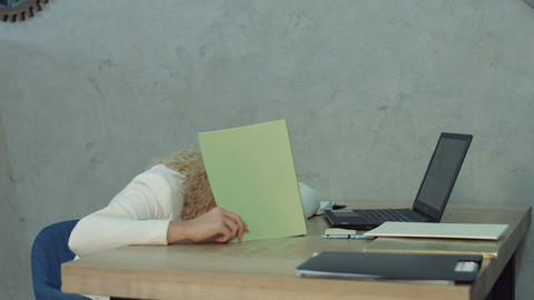 Tired office woman taking a nap at office desk Footage