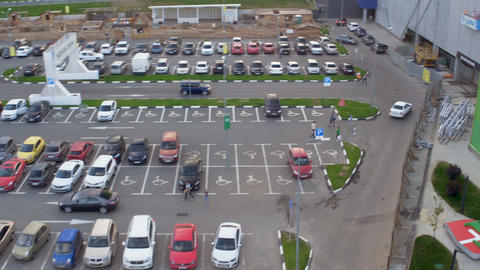 upper view motion over IKEA parking and fountain in park Footage