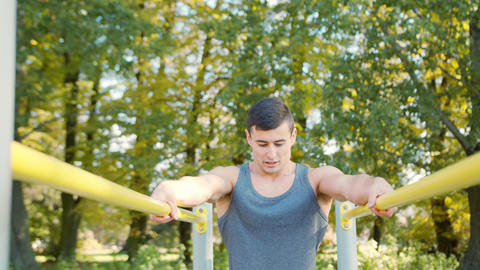 Male Athlete Exercise on Gymnastic Parallel Bars GIF
