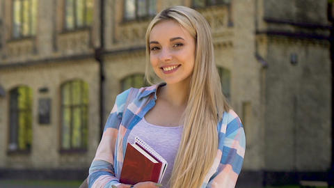 Blond girl smiling at camera, successful student, promising career opportunity Live Action