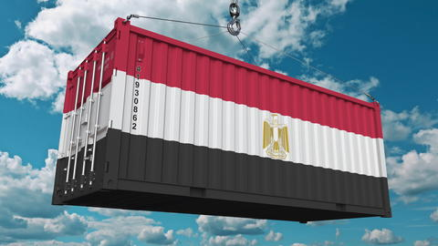 Loading cargo container with flag of Egypt. Egyptian import or export related Photo