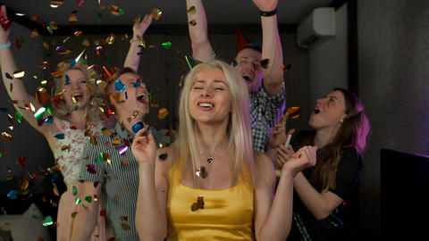 Young attractive lady at great confetti birthday party Live Action