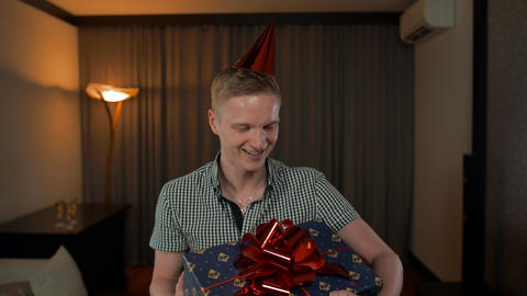 Happy adult caucasian man get gift box Stock Video Footage