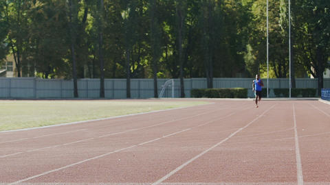 Athlete running fast to achieve best result training actively before competition Live Action