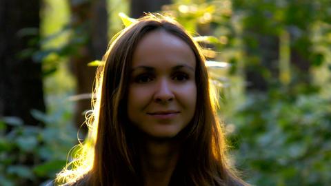 dark girl face against shining in sun long flowing hair GIF