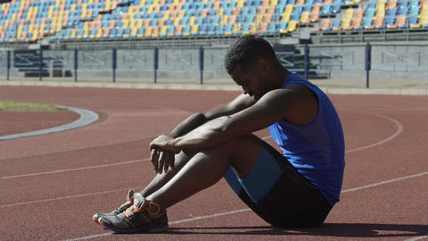 Hispanic athlete restoring breath and strength pondering strategy of training Footage