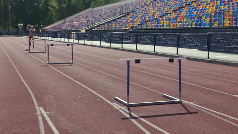 Sportive blonde learning to overcome all difficulties on life path, hurdle race Live Action