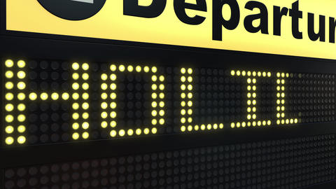 HOLIDAY word appearing on airport departure board ビデオ