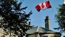 Halifax Nova Scotia New Scotland Canada 080 waving Canadian national flag Footage