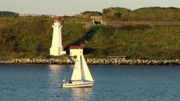 Halifax Nova Scotia New Scotland Canada 015 sailing boat passes lighthouse Footage