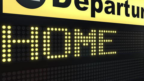 HOME word appearing on airport departure board Live Action