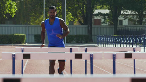 Handsome athlete easily overcoming hurdles achieving success, sense of purpose Footage