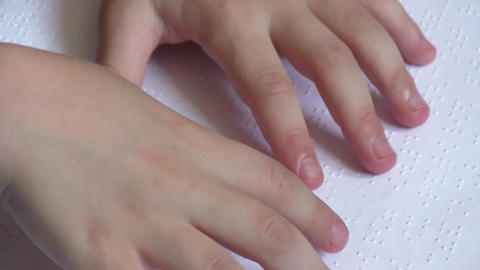 Child learning Braille at school GIF