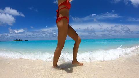 [alt video] Happy Girl Walks on the Beach on Maldives