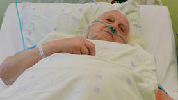 Senior woman in hospital bed Footage