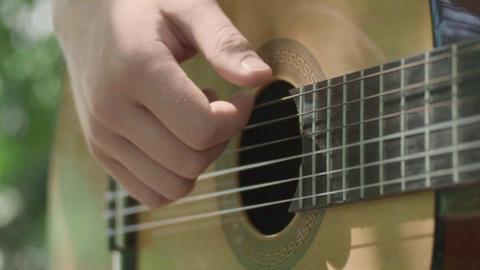 Human hand plays guitar slowly ライブ動画