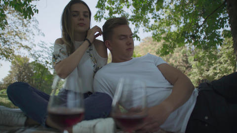 Young couple drink alcohol outdoor Live Action