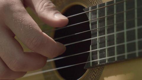 Human hand plays guitar slowly Footage