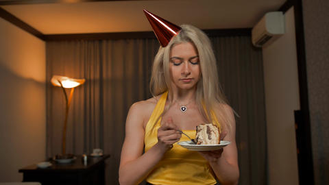 Young woman trying, tasting and eating portion piece of birthday cake ビデオ