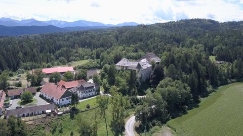AERIAL view of medieval castle, Carinthia, Austria. Mountains on horizon Footage
