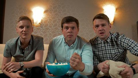 Three best friends watching football tv at home, enjoying good game ビデオ