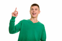 Thoughtful young happy Caucasian man smiling and pointing finger Fotografía
