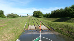 Inclined planes. Sailing over the grass. The boat is sailing through grass Footage
