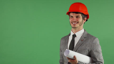 Cheerful handsome engineer holding copy space on his hand Archivo