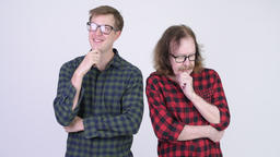 Serious senior hipster man thinking with happy young hipster man thinking Footage