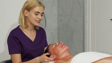 Young professional female therapist smiling to the camera while working Live Action