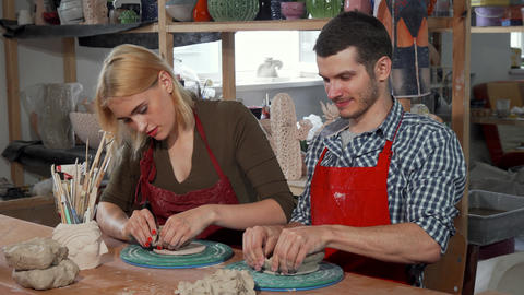 Young entrepreneurs working at their ceramics store Footage