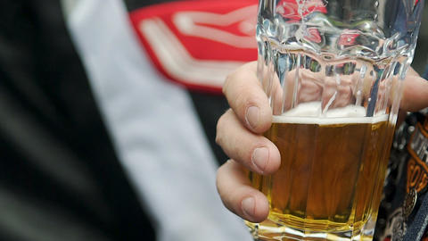 Motorcyclist drinking glass of beer, living biker lifestyle, male entertainment Live Action