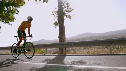 Man cycling on road bike outdoor exercise on an empty road in the morning Footage