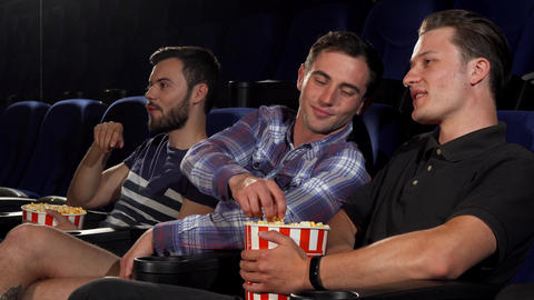 Group of male friends watching movies together at the cinema Footage