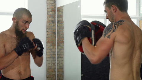 Professional mma fighters practicing at sports club Footage