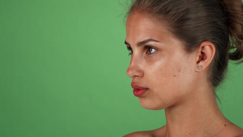 Studio shot of a beautiful young woman with flawless skin looking to the camera Live Action