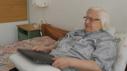 Funny elderly irritated woman is hitting a laptop Live Action
