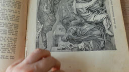 Hands are turning pages of antique german bible Footage