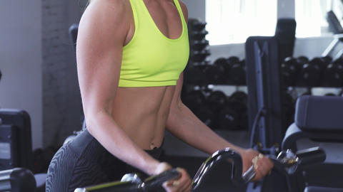 Cropped shot of an athletic woman doing biceps curls at the gym Footage