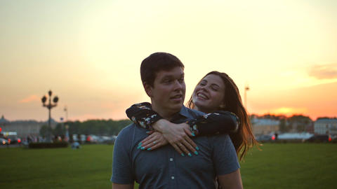 Portrait of a loving couple in the park at sunset Footage