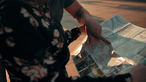Two people, couple, young girl and guy reading city map outdoor Footage