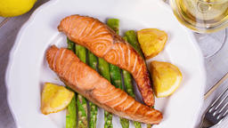 Salmon with Asparagus .Restaurant seafood and dieting concept Footage