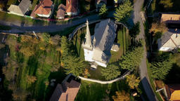 Aerial point of view drone footage of a protestant church in Transylvania, Footage